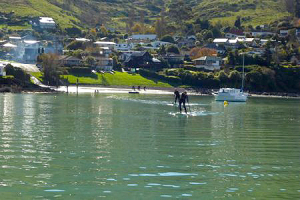 Stand up paddling around Cass Bay , Lyttelton